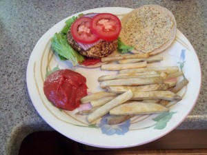 Veggie burger with baked french fries. More easy good vegan cooking.